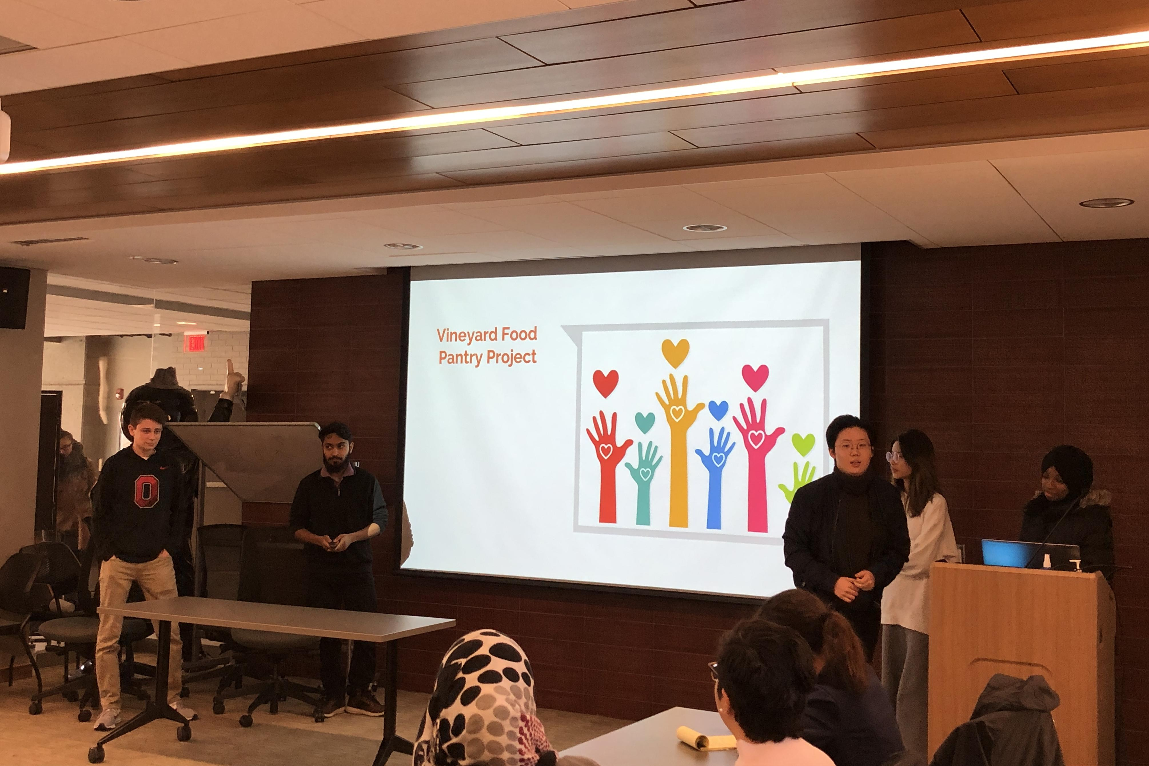 Communication students present about their service-learning project.