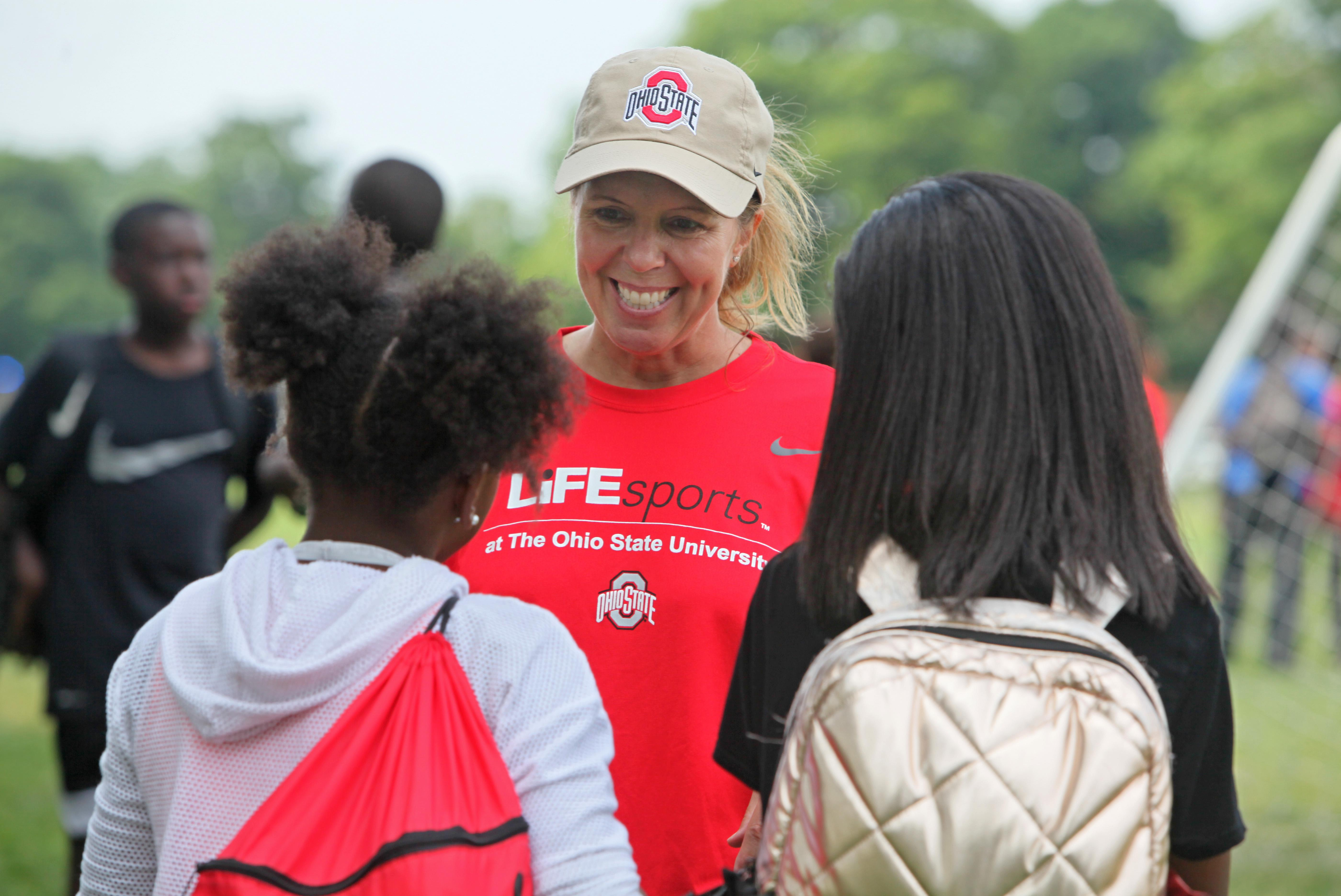 Photo of Dawn Anderson-Butcher with LiFEsports campers at 2019 camp.