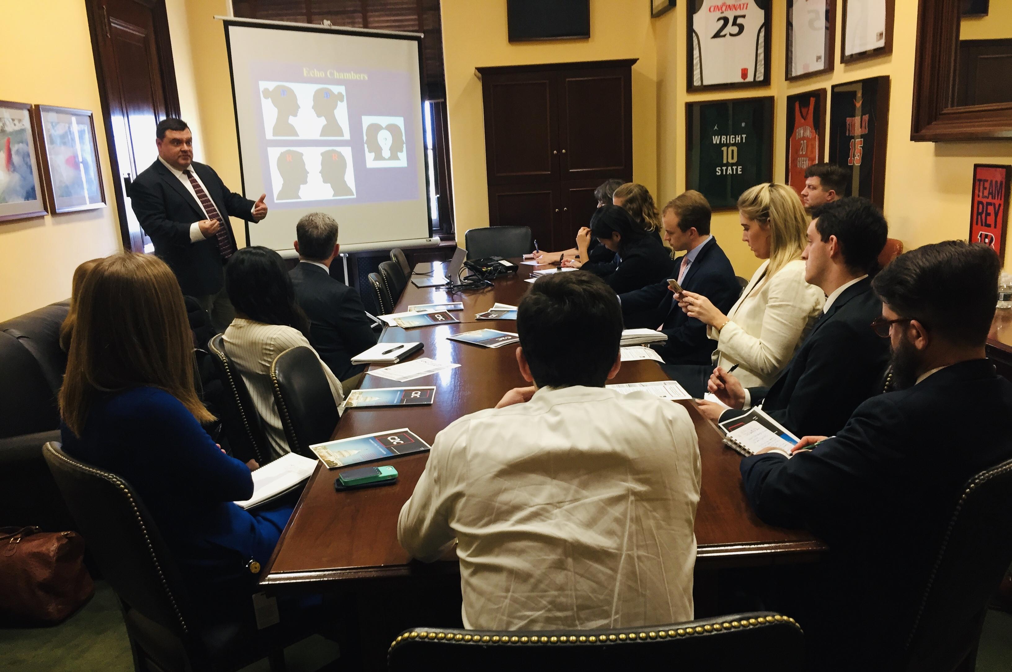 Michael Neblo (standing) presenting in Washington, D.C.