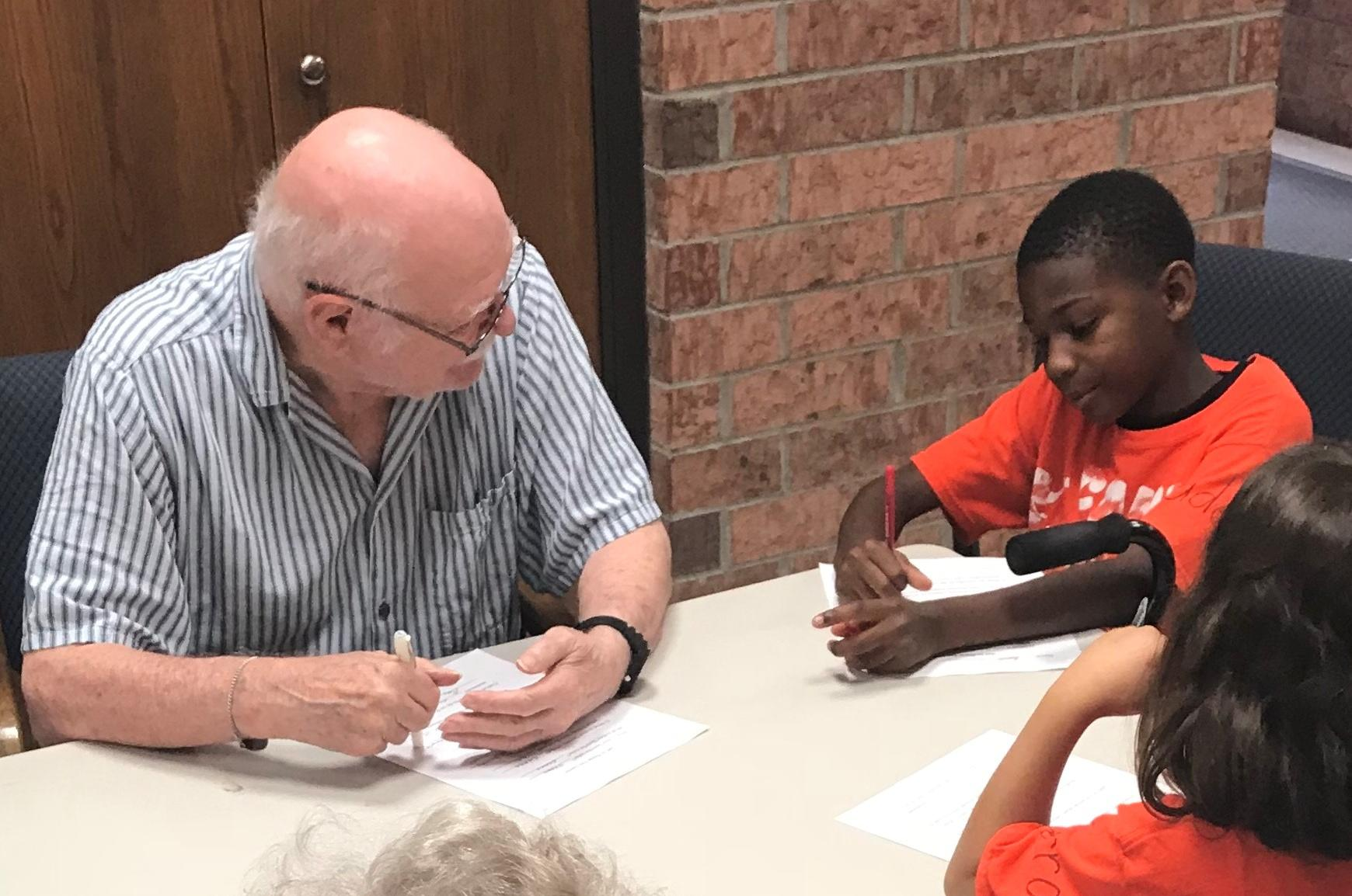 An older adult and child participate in the Get WISE program